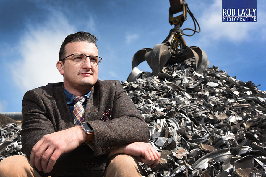 Steven Munnock CEO Avon Metals with pile of scrap precious metal