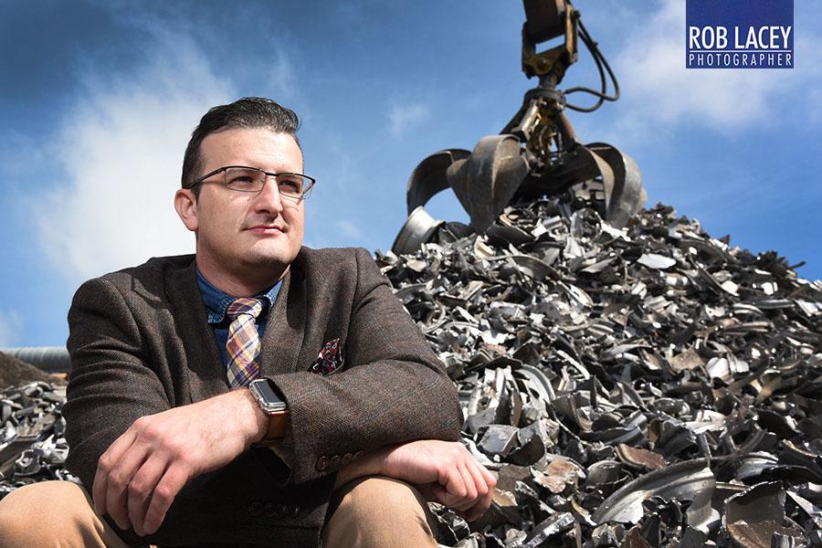 Steven Munnock CEO Avon Metals with pile of scrap precious metal