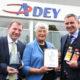 Adey celebrating 2nd Queens Award