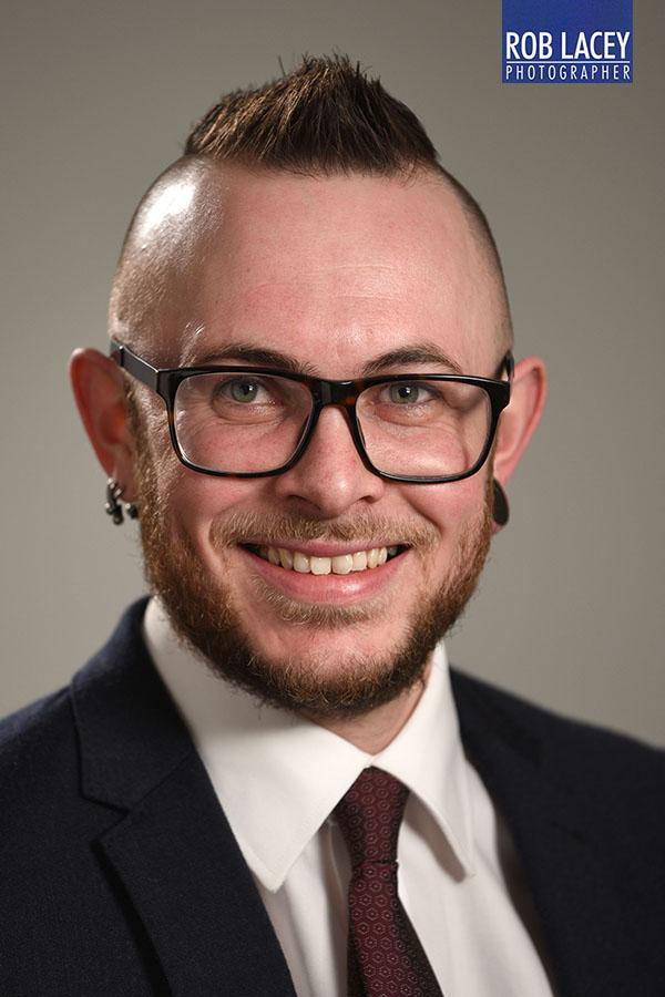 headshot male grey background 1