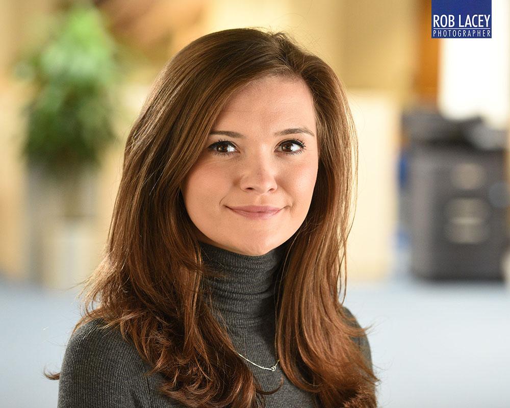 Headshot female office background roll neck horizontal