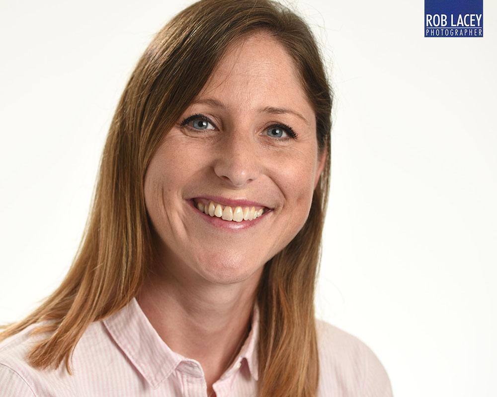 Headshot female white background horizontal cropped