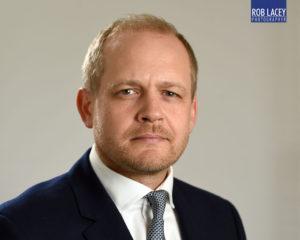 headshot male grey background suit horizontal