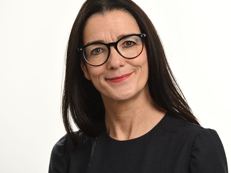 female headshot Birmingham glasses cropped white background