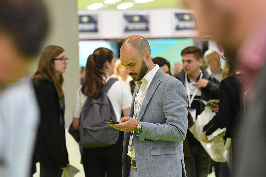 Man on phone at exhibition